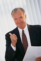 Senior Businessman Giving Thumbs-Up