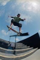Skateboarder Sliding Along Stairway Railing