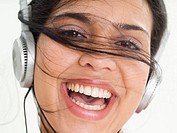 Smiling Woman Listening to Headphones