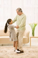 Little Girl Dancing on Grandfather's Feet
