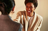Woman Smiles as She is Hired for Job
