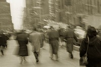 Blurry Back View of Businesspeople Walking in Manhattan
