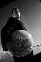 Businessman Holding a World Globe
