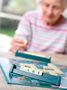 Geriatric care  83 year old woman playing scrabble