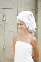 Woman in towel smiling