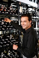 Man taking wine bottle from the wine cellar