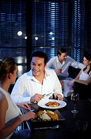 Couple talking while having dinner in a restaurant