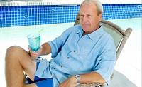 Man relaxing by the pool side