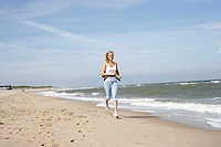 Sandy beach, woman, young, beach run,  Sea, summer,  Netherlands, Oostkapelle, coast, vacation, summer vacation, leisure time, sport, run sport, casua...