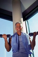 Fitness studio, man, middle age,  Barbell training, Halbporträt,   Series, 40-50 years, 45 years, grey-haired, smiling, cheerfully, gaze camera, short...