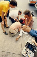 Roadside, sidewalk, victims, First helpers, reanimation,  no models release,  Man, casualties, patient, cardiac arrest, passer-bys, doctor on emergenc...