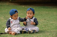 Meadow, boys, Asians, sitting, cell phone,  playing,   Children, toddlers, 3-5 years, twins, two, brothers, Basecap, headgear, Asian, happiness, park,...