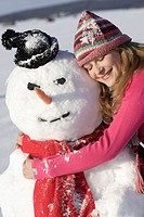 Woman, young, snowman, embraces, happy,  smiling, winters,   Series, 16-18 years, teenagers, teenagers, girls, eyes, rope cap, closed cap, headgear jo...