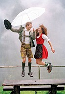 couple, young, traditional costume, Dirndl, leather shorts,  Umbrella, outside, cheerfully, air jump,   Series, 20-30 years, Alm, table, wood bank, ra...