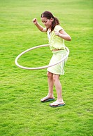 Girl playing the hula hoop