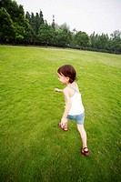 Little girl running at the park