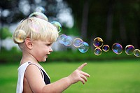 Little boy pointing at bubbles
