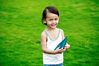 Little girl holding a paper plane