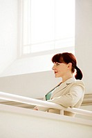 Businesswoman smiling while thinking