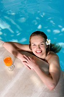 Woman smiling at the camera while soaking in the pool