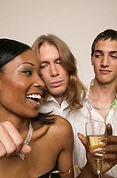 Two young men and young woman at party (thumbnail)