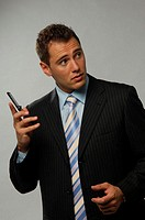 Businessman holding mobile phone in his hand