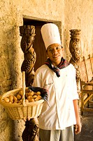 Chef presenting a basket of bread at the Casa Santo Domingo Hotel, Antigua, Guatemala.
