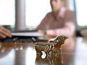 Figurines of bull and bear on desk