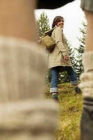 Young couple walking in meadow, focus on woman