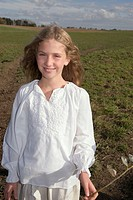 Girl in field, portrait