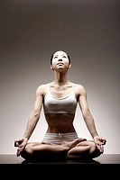 Young Asian woman in lotus position