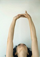 Woman stretching arms over head