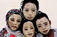 Comoros Republic, Grande Comore island, group of children having a massinzanou face pack