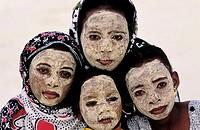 Comoros Republic, Grande Comore island, group of children having a massinzanou face pack