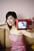 Woman using camera to take photo of herself