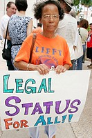 Black Hispanic woman. Immigration rights protest. Government Center. Miami. Florida, USA.