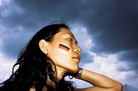 a chinese women with the German Flag on her face