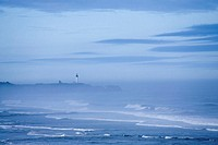 USA, Oregon, Yaquina Head, waves breaking and fog