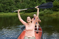 Mature couple having fun canoeing