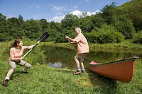Mature couple playing with oars