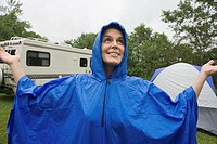 Woman wearing a blue plastic raincoat