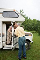 Mature couple kissing in caravan