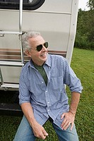 Mature man with his caravan