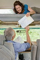 Couple passing a map in caravan