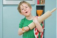 Boy with a rolling pin