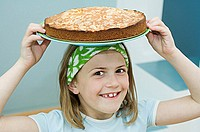 Girl with a cake on her head