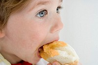 Child eating piece of bread