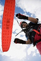 Male parachutist with red parachute (thumbnail)