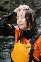Female kayaker with hand in hair