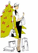 Fashionable woman with shopping bags in front of Christmas tree